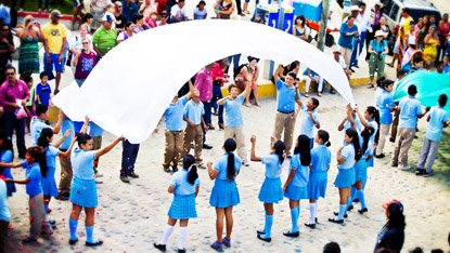 Schoolkids performing in the parade