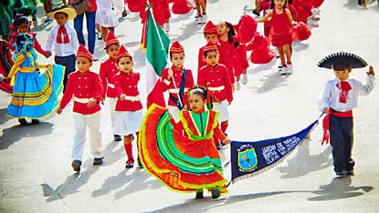 Kids on parade, in full dress uniforms