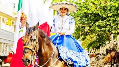 The rodeo riders are called Charros; the women, like this one, are Charras