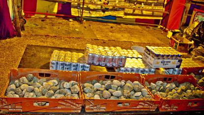 Piles of rocks, cases of beer. Throw a rock, break a bottle, win beer