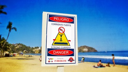 Signs like this hopefully will make people more cautious about swimming when there are big waves