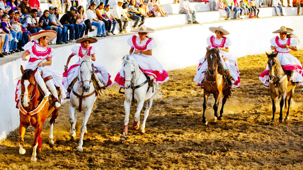 -en-fancy-dress-women-riding-the-ring-at-a-sayulita-rodeo-es-adelita-en-la-charreada-